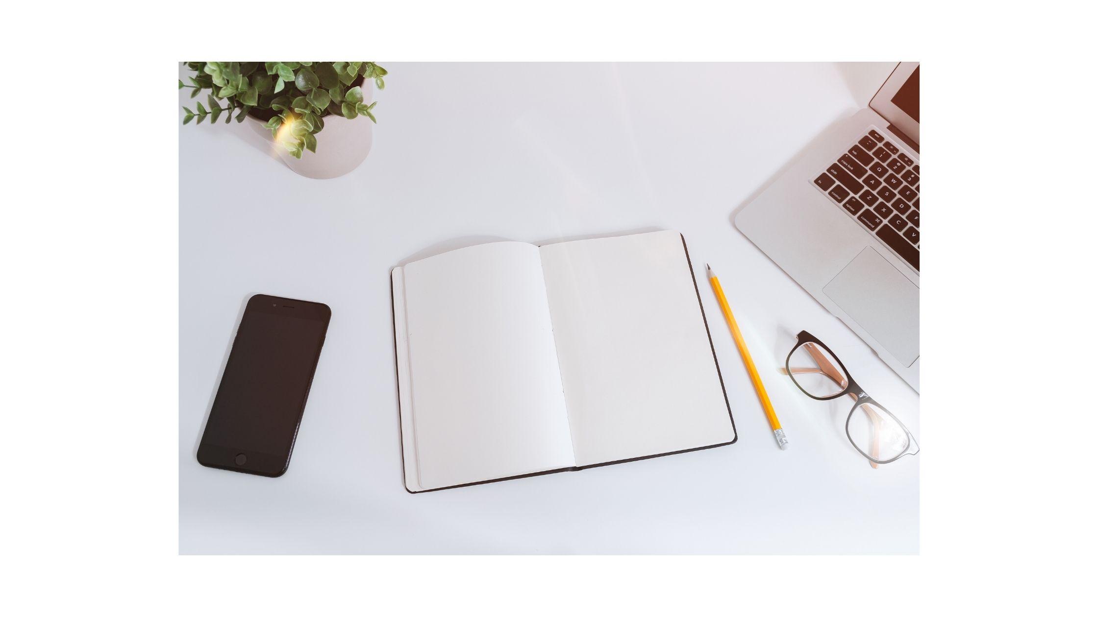 An open book next to a computer